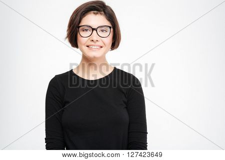 Happy casual woman in glasses looking at camera isolated on a white background