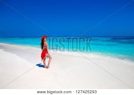 Beautiful Woman In Hat Enjoying Summer Vacation On Exotic Beach By Tropical Blue Water. Attractive G