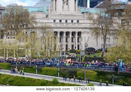 LONDON, APRIL 24, 2016: Spectators gathered to watch the London Marathon at 10 Trinity Square