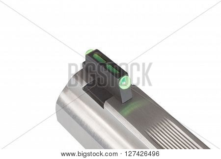 Green fiber optic front sight on a handgun isolated on white