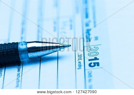 US tax form with pen on the table