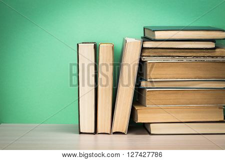 Old books on a wooden shelf. Close up.