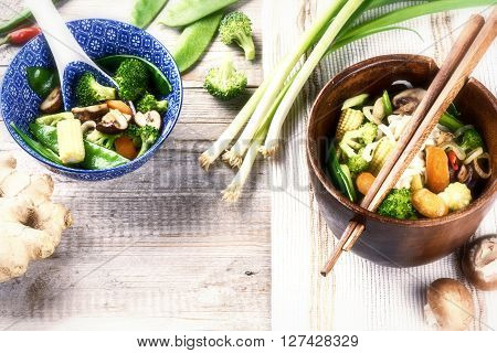 Asian noodles with stir-fried vegetables. Food background with copyspace