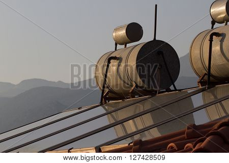 Background of roofs with heating tank on top. Turkey