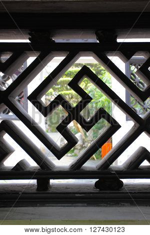 Swastika - decorative element of bars in ancient Yu Yuan Garden in Shanghai, China. Shallow DOF!