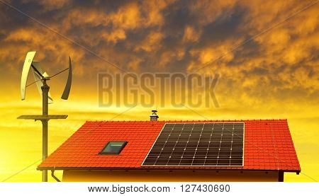 Solar panel on the roof of the house in the background wind turbine at sunset.