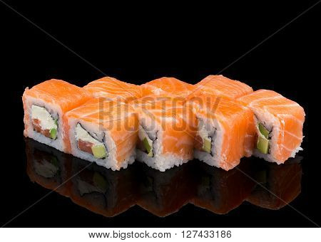 Japanese Cuisine. Salmon Sushi Roll Over Black Background.