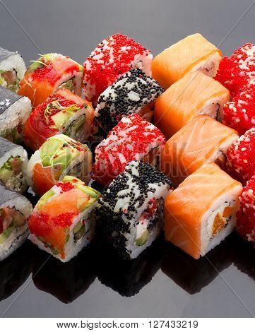 Japanese Cuisine. Sushi Set Over Black Background.