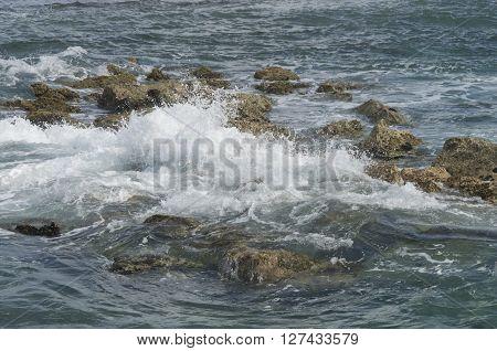 Waves crash among the rocks along the shore in Labadee Haiti