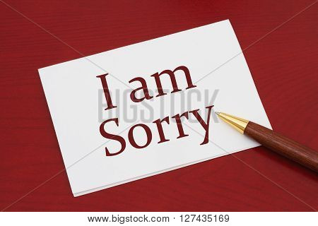 I am Sorry Card White Greeting card with text I am Sorry on a red wood background