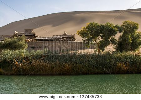The lake and pavilion in desert Dunhuang Mingsha Shan China
