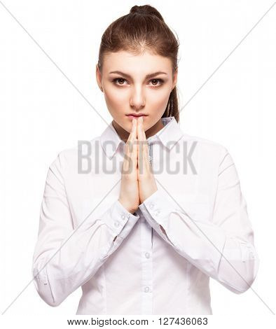 Praying young woman. Female with folded hands isolated on white