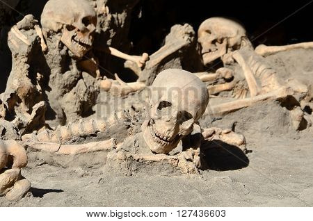 skulls of long time ago dead men in the ruins of Ercolano Italy