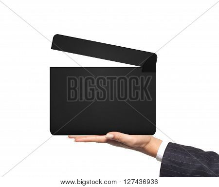 Movie clapperboard in woman hand isolated on white background