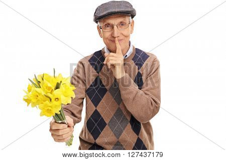 Romantic senior holding a bunch of flowers and holding a finger on lips isolated on white background