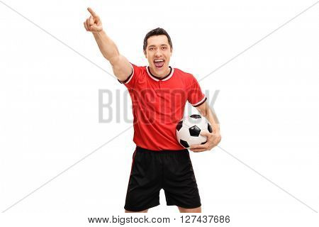Joyful football player celebrating something and looking at the camera isolated on white background
