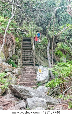 STORMS RIVER MOUTH SOUTH AFRICA - MARCH 1 2016: Unidentified hikers on the Waterfall Trail which is part of day one of the renowned Otter Trail