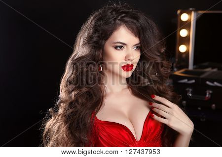Makeup. Hairstyle. Beautiful Girl With Long Wavy Hair. Brunette Model With Red Lips In Sensual Dress