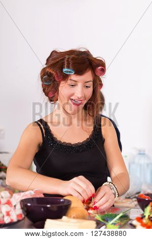 Young Pretty Woman Housewife Cooking With Curler Hair