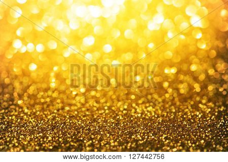 Sparkling or shimmering gold background. Micro gold glitter with  intense sparkle. Good christmas and gift season background.  Soft focus.