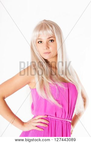 Pretty Young Woman In Blonde Wig And Pink Dress