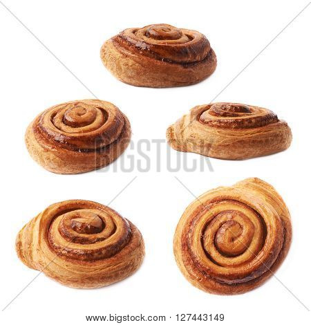 Sweet cinnamon bun roll swirl isolated over the white background, set of five different foreshortenings
