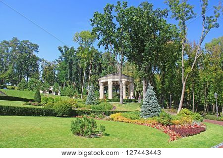 KYIV, UKRAINE - SEPTEMBER 14, 2014: Mezhyhirya - former private residence of ex-president Yanukovich now open to the public, Kyiv region, Ukraine. Park near building