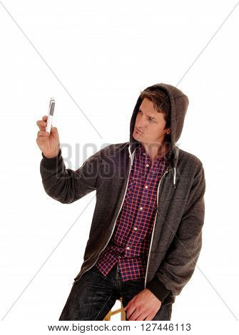 A young man in a gray hoody and checkered shirt taking a picture of himself isolated for white background.