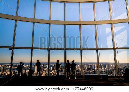 Silhouette people with Observation windows  in Tokyo views of skyscrapers Japan