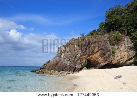 clear water sea and rough rock stone at Tropical white bay beach with sunset nature composition