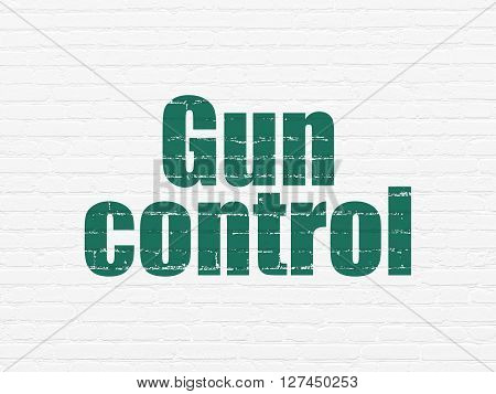 Security concept: Painted green text Gun Control on White Brick wall background