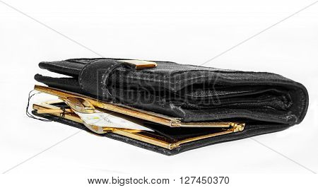 Traps for money in closed purse isolated on white background
