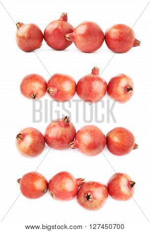 Four pomegranate fruits composition isolated over the white background, set of four different foreshortenings