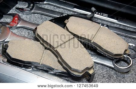 Close-up of automotive disc brake pads in a toolbox