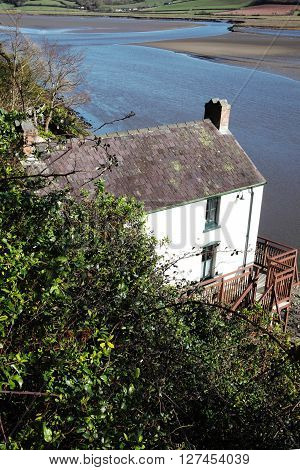 Laugharne,Wales, UK, February 24, 2016 : The Dylan Thomas Boathouse overlooking the Taf estuary,where the poet lived for the last four years of his life