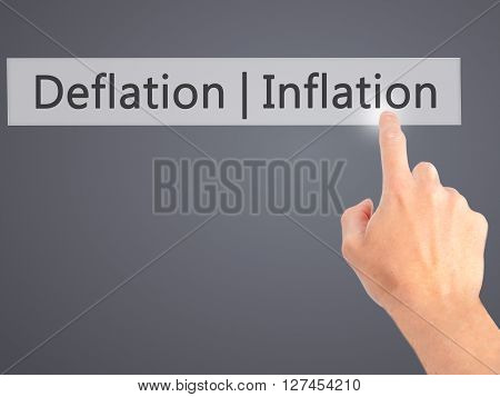 Deflation Inflation - Hand Pressing A Button On Blurred Background Concept On Visual Screen.