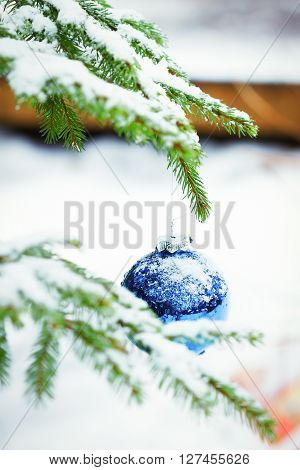 Christmas balls outdoors in snow New Year