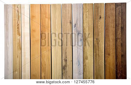 Colorful background texture and pattern of different wood varieties and colors in upright parallel planks in a full frame view