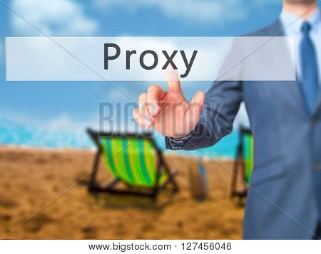 Proxy - Businessman Hand Pressing Button On Touch Screen Interface.