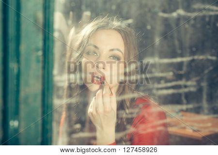 Woman In Old Retro Mirror