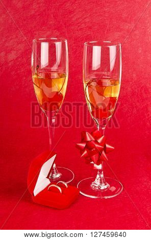 Two holiday goblets champagne glasses jewelry ring