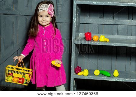 Small Girl With Plastic Food