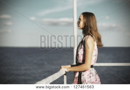 Young girl on the pier (ancient version)
