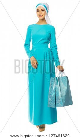 Muslim woman in blue dress with bags isolated