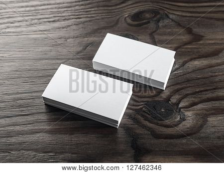Blank business cards on wooden table. Template for ID. Top view. Stacks of blank business cards on wooden background.