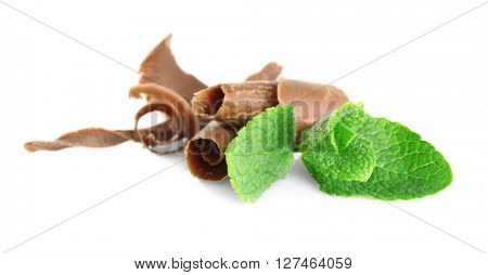 Milk chocolate chips with fresh mint, isolated on white