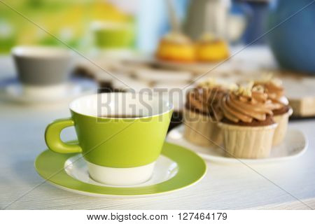 Table setting with tea and cakes indoors