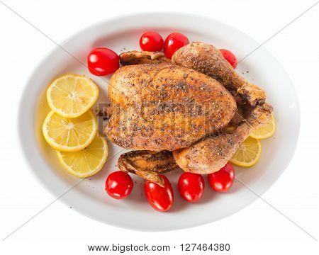 Roasted chicken on a plate on white