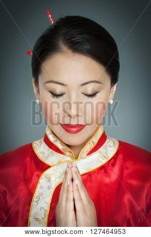 Praying Asian Woman