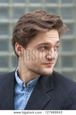Portrait of a Young Man with Brown Hair Outdoors.